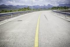 Road at ratchaprapa dam, Suratthani. Road at ratchaprapa dam, Suratthani, Thailand Stock Photo