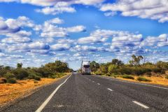 Road Rd Train Far NSW outback. Remote empty road Castlereagh highway B55 in rural outback part of NSW, Australia with lonely distant road train truck royalty free stock photo