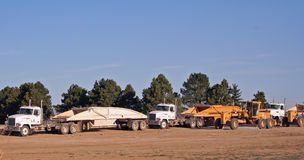 Road Ready. Several large pieces of earthmoving equipment lined up on a construction or development site Stock Photography