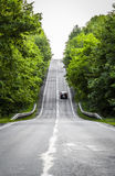 The road receding into the distance. The road through the woods, disappearing into the distance royalty free stock image