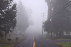 Road receding into fog Stock Images