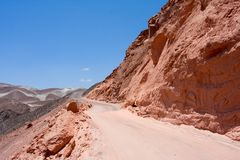 Road in red desert in Peru Stock Photo