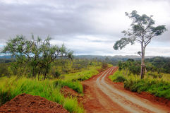 Road at red dirt. Nearby Sogeri village, Papua New Guinea Stock Images