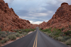Road through red hills Stock Image