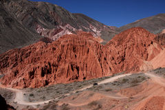 Road through red mountains in Pumamarca Royalty Free Stock Photo