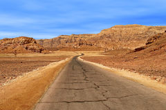 Road through red mountains in Timna park. Royalty Free Stock Image