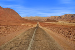 Road and red mountains in Timna park. Stock Images