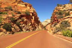Road between red rocks, Zion National Park, Utah, USA Stock Photography