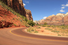 Road between red rocks, Zion National Park, Utah, USA Stock Image