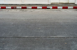 Road with red and white curb. Concrete road with red and white curb Royalty Free Stock Image