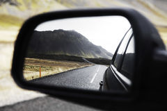 Road Reflecting on Car Side Mirror Stock Image