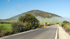 Road with remnants of mist Royalty Free Stock Photo