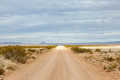 A road in remote New Mexico. Looking along a long straight road in rural New Mexico stock photos