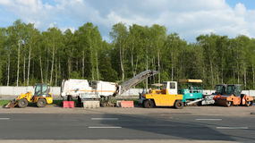 Road repair. Machines stand on the roadside Royalty Free Stock Photos