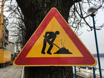 Road repair sign. Street road under construction. Road signs on the roadside along the road warning about the repair. Stock Photo