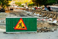 Road repair sign. Work in progress. Direction sign Arrow, road signs. Men at work. Some sign signs for work in progress on a city street. Barriers and road signs stock image