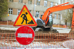 Road repair signs. And equipment in the city street Stock Images