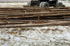 Road repair. Steel rails and vehicles on the ground Stock Photos