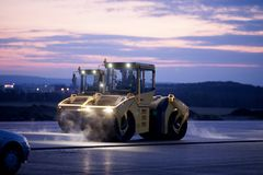 Road repair, vibration rollers at asphalt pavement works.  Royalty Free Stock Photo