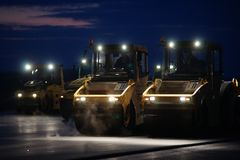 Road repair, vibration rollers at asphalt pavement works.  Royalty Free Stock Images