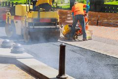 Road repairing in urban modern city with heavy vibration roller compactor. Road Construction Stock Photography
