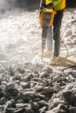 Road repairing works with jackhammer. At night Stock Images