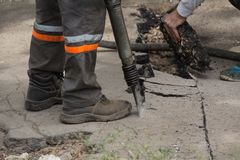 Road repairing works with jackhammer Stock Photos