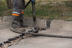 Road repairing works with jackhammer Stock Images