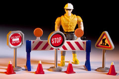 Road Repairs - Toy Worker & Road Signs Stock Photography