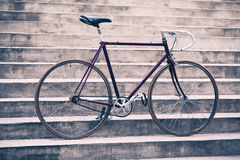 Road retro bicycle and concrete stairs, urban scene vintage styl Stock Image