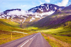 The road among rhyolitic mountains Royalty Free Stock Photos
