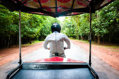 On the road, rickshaw driver Stock Photography