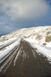 Road right to snow Royalty Free Stock Image