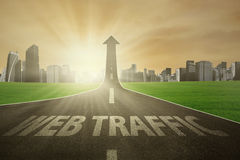 Road rises upward with web traffic text. The word of Web Traffic on a road rising upward, symbolizing web activity growing up Stock Photos