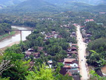 The road and the river. A road in Luang Prabang and the Mekong river, as seen from a hill top temple. Laos Stock Images