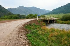 Road, river and bridge, royalty free stock photography