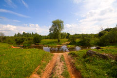 Road with river ford. Crossing river, summer rural landscape Royalty Free Stock Photos