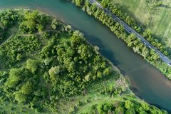 Road, river and forest aerial view. Drone photo. Road, river and forest aerial view. Picture taken with a drone royalty free stock images