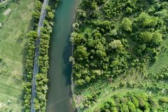 Road, river and forest aerial view. Drone photo. Road, river and forest aerial view. Picture taken with a drone stock photos