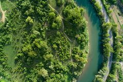 Road, river and forest aerial view. Drone photo. Road, river and forest aerial view. Picture taken with a drone stock image