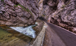 Road and river in gorges Stock Image