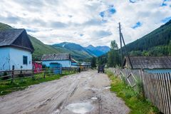 Road and river in Karakol national park, Kyrgyzstan Royalty Free Stock Photo