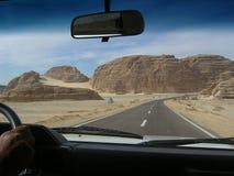 Road in rock desert Stock Photos