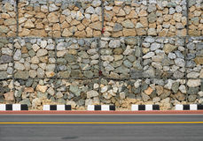 Road with rock wall Royalty Free Stock Image