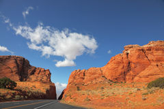 The road among rocks of red sands Royalty Free Stock Image