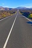 Road between rocks  in Timanfaya national Park Royalty Free Stock Image