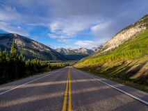 A road through Rocky Mountains Stock Images