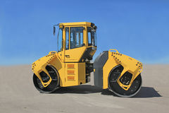Road-roller. Yellow road-roller on repairing of the road Stock Photo