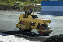 Road-roller. On the work stock photo