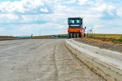 Road roller building the new road Royalty Free Stock Image